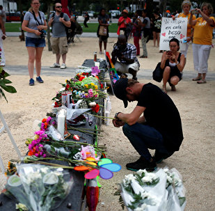 Bryant Woernley prays for the deceased ahead of a candle light vigil in memory of victims one day after a mass shooting at the Pulse gay night club in Orlando, Florida, U.S., June 13, 2016.