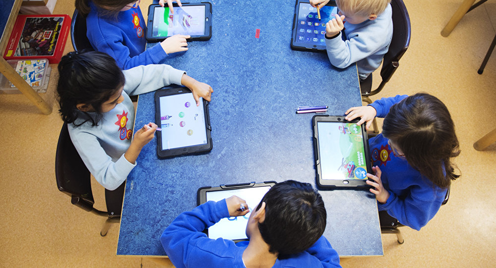 Nursery school pupils work with iPads in Stockholm