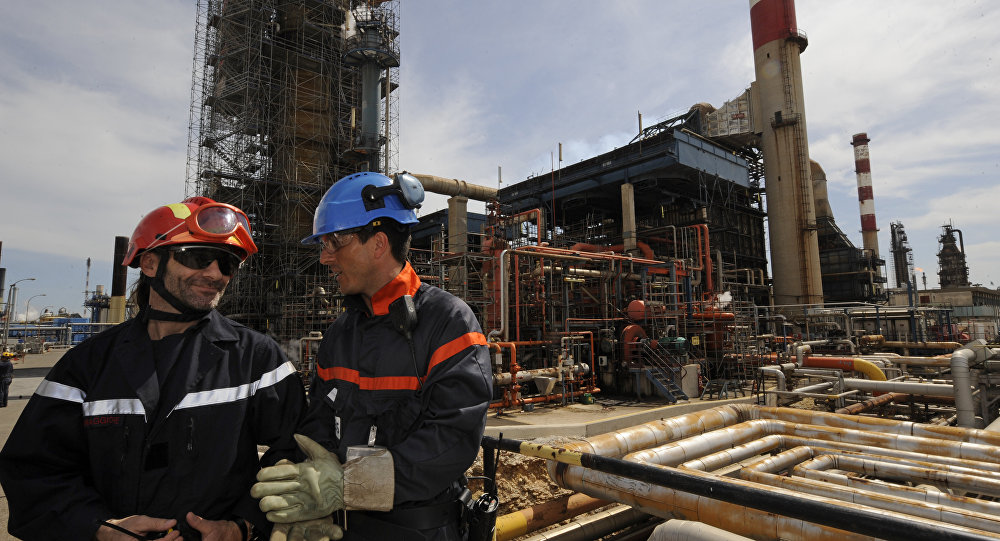 Workmen stand at the site of the mediterranean refinery of Lavera which belongs to British group Ineos. (File)