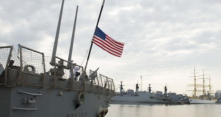 The American flag flies at half-mast aboard the guided-missile destroyer USS Porter (DDG 78) during a scheduled port visit to Constanta, Romania June 13, 2016.