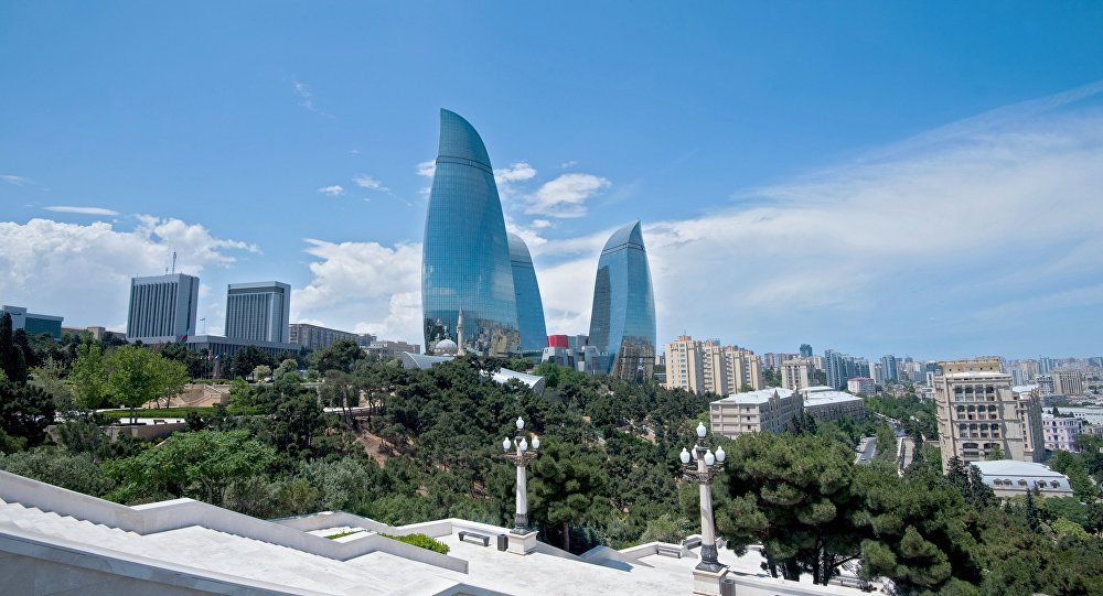 Flame Towers, the tallest buildings in Azerbaijan, and the Milli Majlis (National Assembly) of Azerbaijan, left, in Baku.