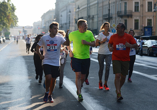 Presidential spokesman Dmitry Peskov, second left, during the SPIEF Race sporting event, organized as part of the St. Petersburg International Economic Forum