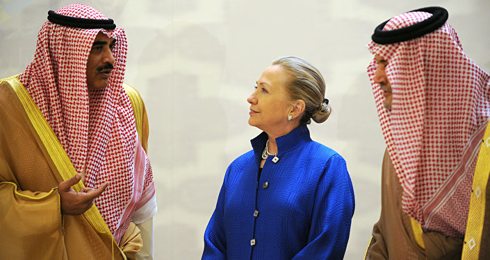 Saudi Foreign Minister Prince Saud Al-Faisal (R), US Secretary of State Hillary Clinton and Kuwaiti Foreign Minister Sheikh Sabah Khaled al-Hamad Al-Sabah speak prior to their group photo with other Gulf counetrparts during their meeting in the Saudi capital of Riyadh, on March 31, 2012