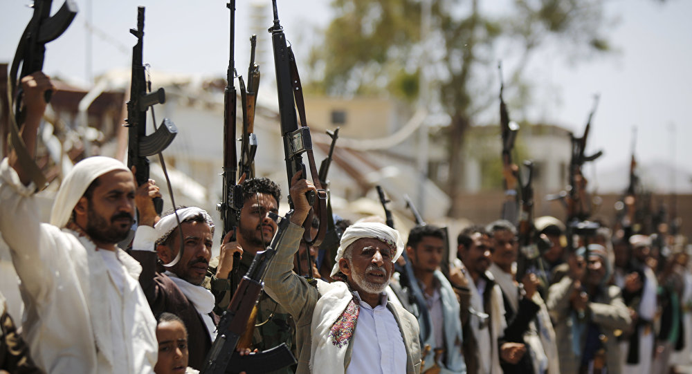 Shiite Houthi tribesmen hold their weapons as they chant slogans during a tribal gathering showing support for the Houthi movement, in Sanaa, Yemen, Thursday, May 19, 2016