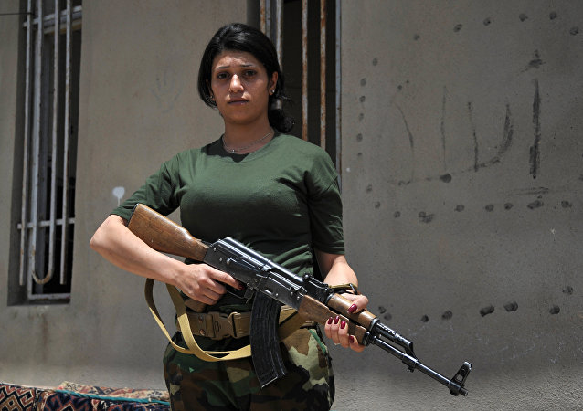A female volunteer from Hezi-Agri (Power of Fire) detachment which fights against ISIS