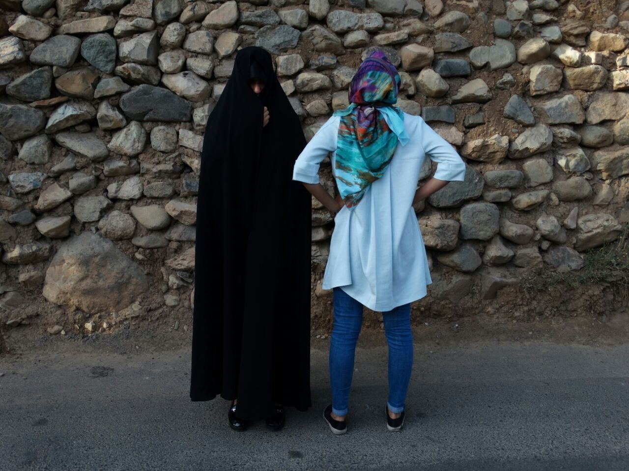 Today in the streets of Tehran and other large Iranian cities (Isfaghan, Shiraz, Tebriz) often women are seen wearing two types of hijabs: Chador (left) and Manto (loose colorful body cover) with Rosari (light headscarf with colorful flowers). First option is more conservative, second is modern and popular with the younger generation.