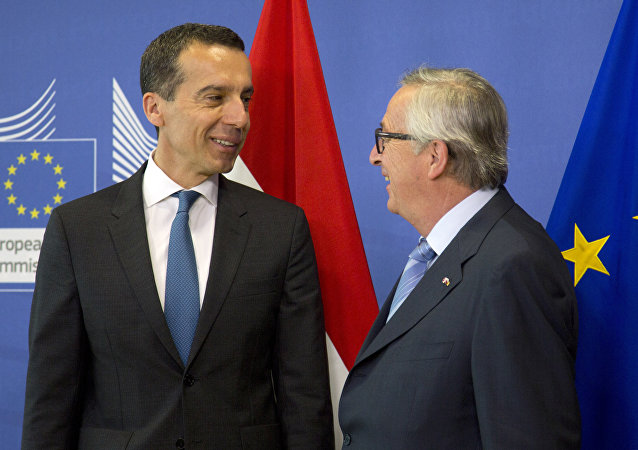 European Commission President Jean-Claude Juncker, right, greets Austrian Federal Chancellor Christian Kern prior to a meeting at EU headquarters in Brussels on Wednesday, June 22, 2016.