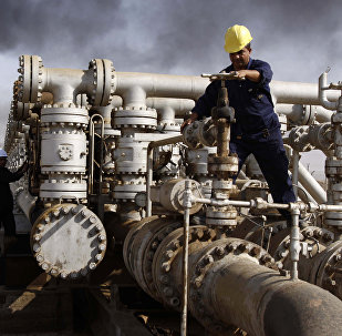 Iraqi workers are seen at the Rumaila oil refinery, near the city of Basra, 550 kilometers (340 miles) southeast of Baghdad, Iraq