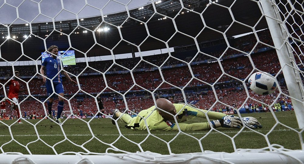 Austria's David Alaba, Iceland's Birkir Bjarnason and Austria's goalkeeper Robert Almer, from left, during the 2016 UEFA European Championship group stage match between the national teams of Iceland and Austria
