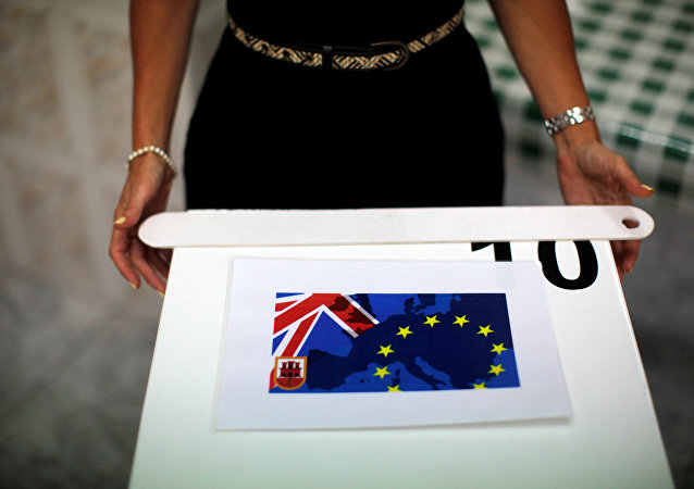 A member of a polling station stands next to a polling box as she waits for citizens during the EU referendum in the British overseas territory of Gibraltar, historically claimed by Spain, June 23, 2016.