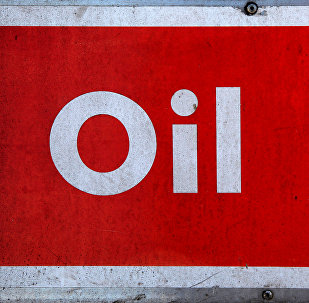 The word oil is pictured on an oil bank at a recycling yard in London