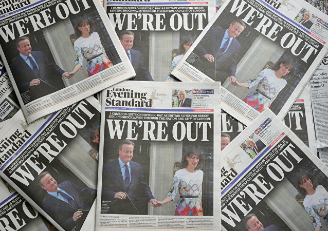 An arrangement of newspapers pictured in London on June 24, 2016, as an illustration, shows the front page of the London Evening Standard newpaper reporting the resignation of British Prime Minister David Cameron following the result of the UK's vote to leave the EU in the June 23 referendum.