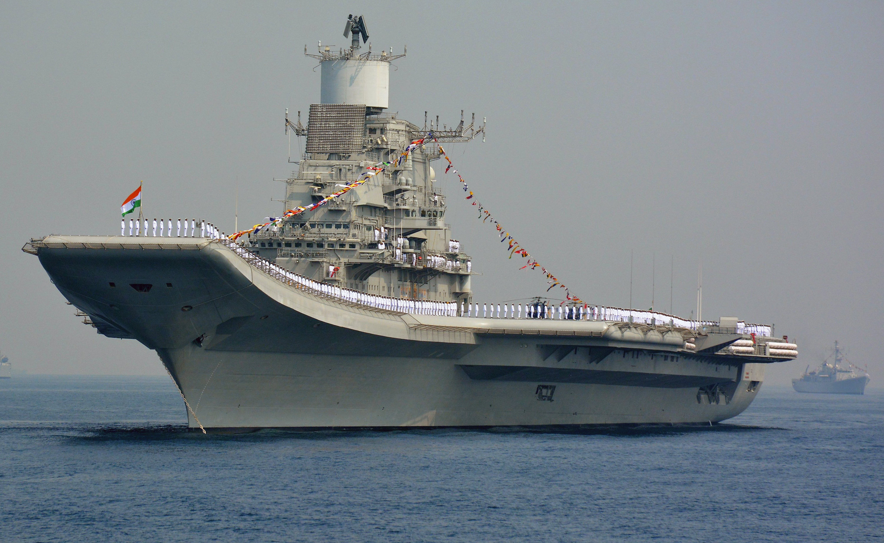 Indian Navy personnel stand on the INS Vikramaditya, a modified Kiev-class aircraft carrier, during the International Fleet Review in Visakhapatnam on February 6, 2016