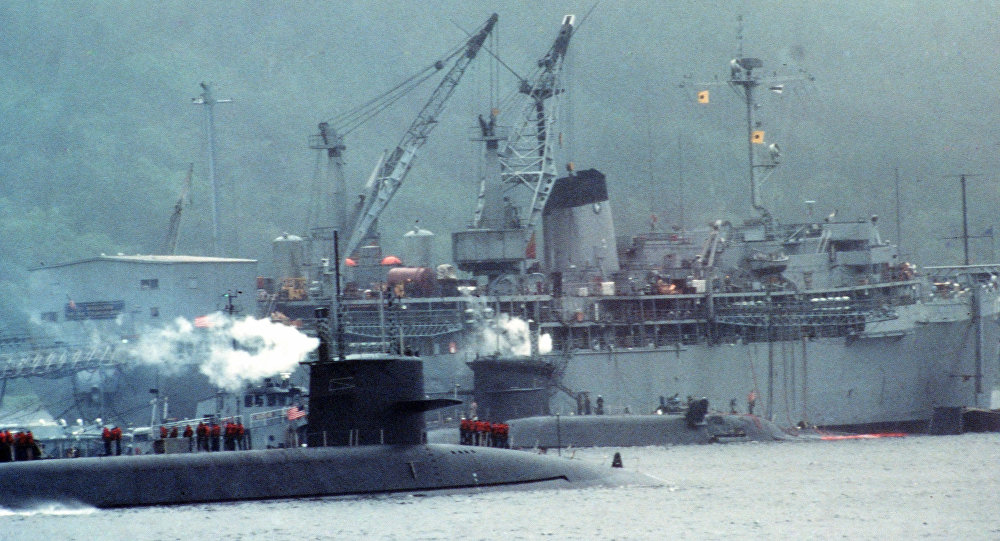 Two US Navy submarines alongside the fleet ballistic missile submarine tender USS Hunley (AS-31) at Navy Fleet Ballistic Submarine Refit Site 1 at Holy Loch, Scotland (UK), 1 December 1985 (File photo).