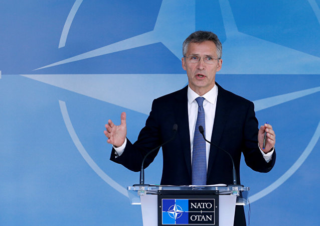 NATO Secretary-General Jens Stoltenberg briefs the media during a NATO defence ministers meeting.