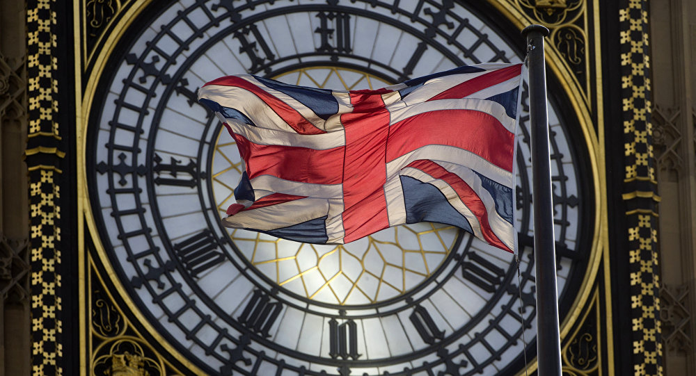 The Union flag is seen flapping in the wind in front of one of the faces of the Great Clock atop the landmark Elizabeth Tower that houses Big Ben at the Houses of Parliament where lawmakers are expected to vote in favour of joining air strikes against Islamic State (IS) militants in central London on 26 September, 2014