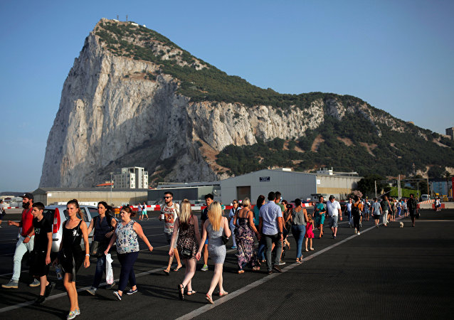 Pedestrians cross the tarmac at Gibraltar International Airport in front of the Rock near the border with Spain in the British overseas territory of Gibraltar, historically claimed by Spain, June 24, 2016, after Britain voted to leave the European Union in the EU referendum.