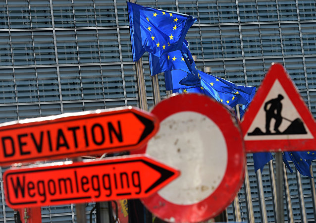 This photo taken on September 25, 2015 in Brussels shows signs for construction work around the Schuman roundabout area, home to the European Union's core institutions