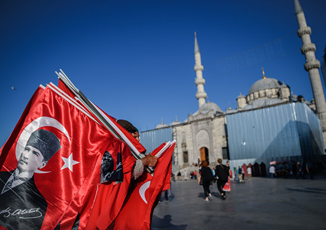A man sells Turksih national flags and poster flags of Mustafa Kemal Ataturk, founder of modern Turkey near the new mosque at Eminonu district in Istanbul, on June 9, 2016
