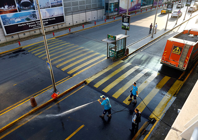 Workers wash the road at Turkey's largest airport, Istanbul Ataturk, following yesterday's blast June 29, 2016