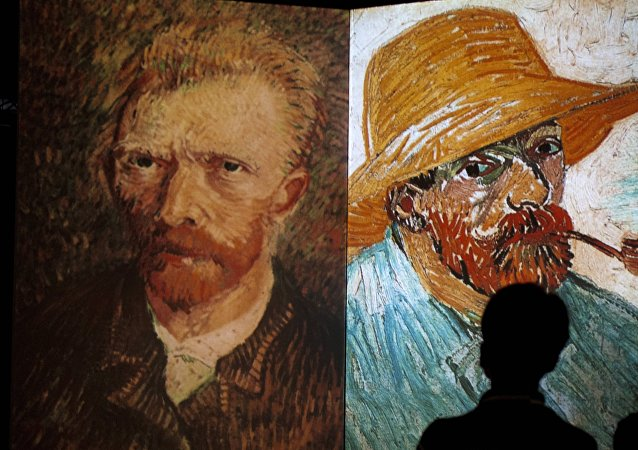A visitor stands in front of giant screens featuring images of the work of Dutch painter Vincent van Gogh during a traveling multimedia art exhibition entitled Van Gogh alive on February 4, 2013