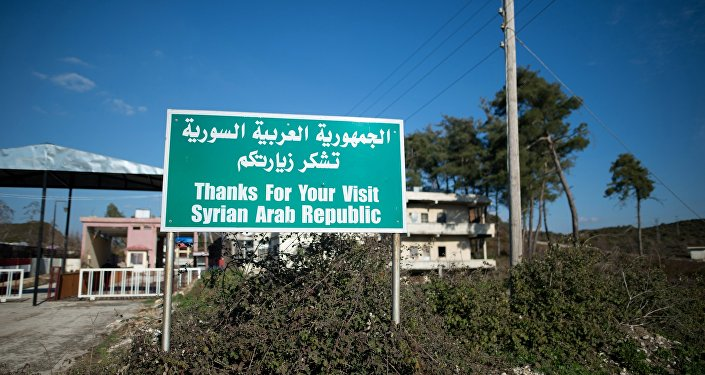 A sign by a closed checkpoint at the Syrian-Turkish border near the town of Kessab