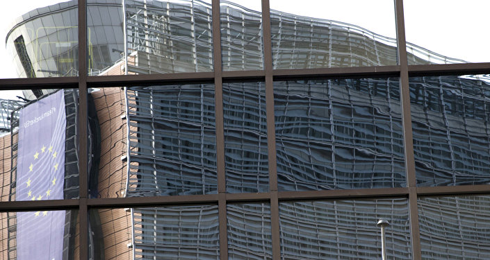 European Union headquarters is reflected in the windows of the EU Council building.