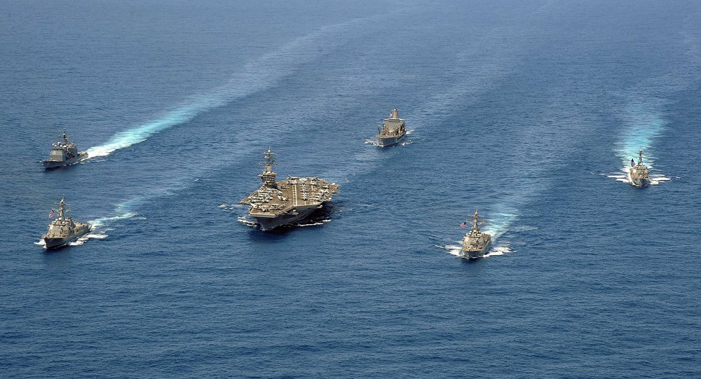 Ships from Carrier Strike Group 8 are in formation for a photo exercise in the Atlantic Ocean