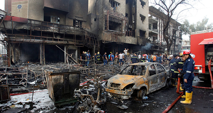 People gather at the site of a suicide car bomb in the Karrada shopping area, in Baghdad, Iraq July 3, 2016