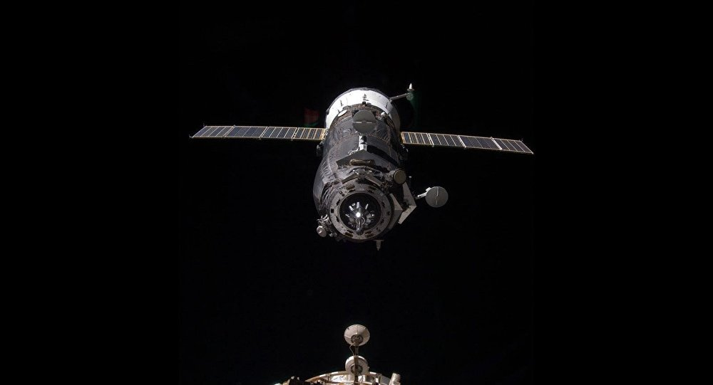 An unpiloted Progress resupply vehicle approaches the International Space Station