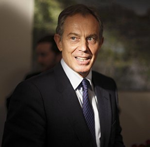 Former British Prime Minister Tony Blair arrives for an interview at the Blair Faith Foundation in central London, Britain November 17, 2009.