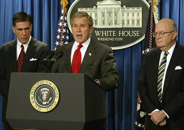 President George W. Bush (C) names Democratic former senator Chuck Robb (L) and former judge Laurence Silberman (R) as co-chairs of an independent commission to examine pre-war intelligence on Iraq's weapons of mass destruction. February 6, 2004, Washington, DC.