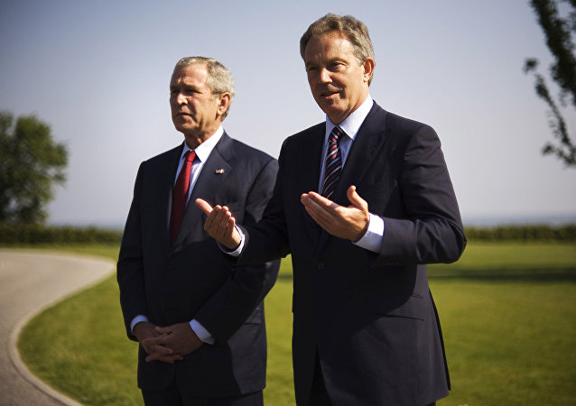 Then US President George W. Bush (L) and then Britain's Prime Minister Tony Blair address journalists following a bilateral meeting 07 June 2007 on the sidelines of the G8 Summit in Heiligendamm, northeastern Germany.