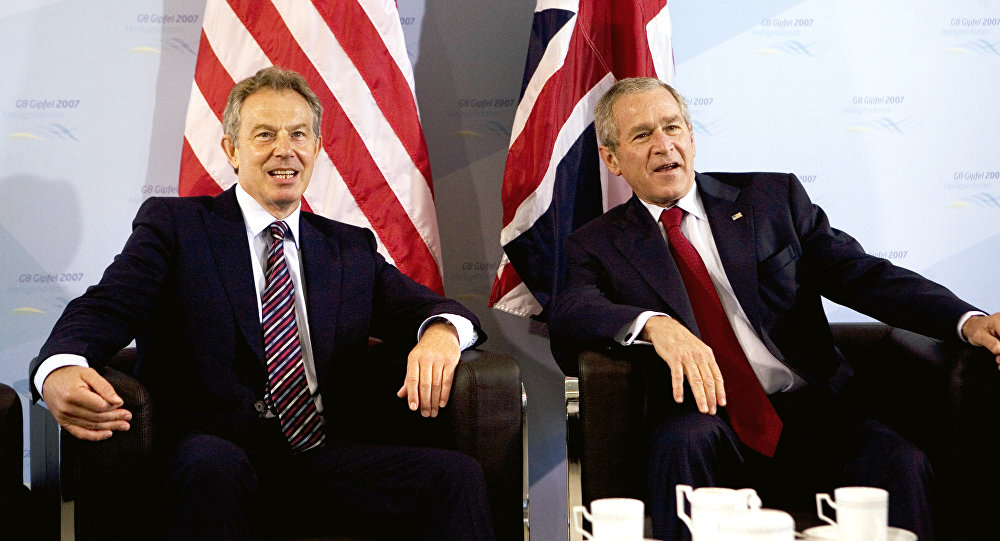US President George W. Bush (R) and Britain's Prime Minister Tony Blair pose for photographers prior a bilateral meeting 07 June 2007 on the sidelines of the G8 Summit in Heiligendamm, northeastern Germany.
