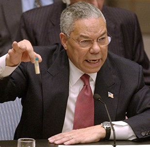 The image seen round the world of Secretary of State Colin Powell and his mock vial of anthrax,which he held up during a presentation before the UN on Iraq's alleged weapons of mass destruction program, February 5, 2003.