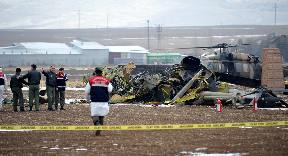 Turkish officials examine the wreckage of a Turkish military S-70 Sikorsky helicopter (File)