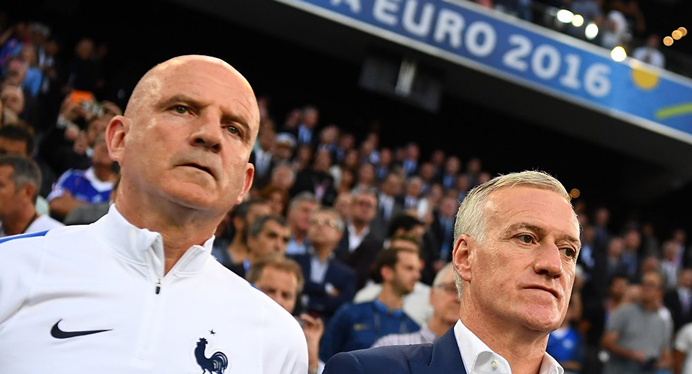 France assistant coach Guy Stephan (L) and France's coach Didier Deschamps look on at the start of the Euro 2016 semi-final football match between Germany and France at the Stade Velodrome in Marseille on July 7, 2016.