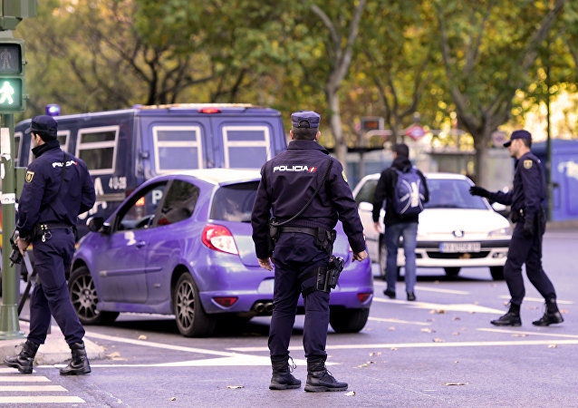 Policemen stop a car to check it in front of Santiago Bernabeu stadium before the Spanish league Clasico football match Real Madrid CF vs FC Barcelona at the Santiago Bernabeu stadium in Madrid