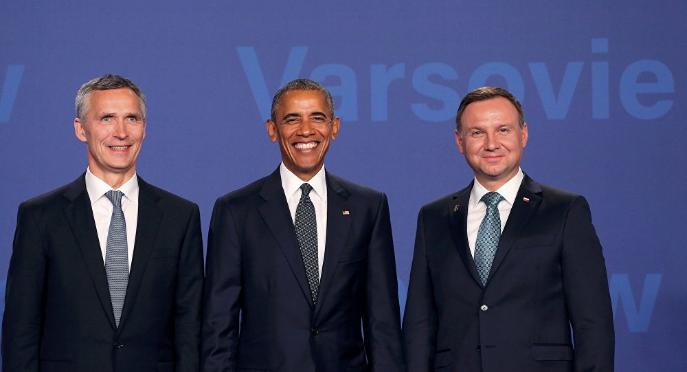 U.S. President Barack Obama (C) poses for a picture next to Poland's President Andrzej Duda (R) and NATO Secretary-General Jens Stoltenberg as he arrives at the NATO Summit at PGE National Stadium in Warsaw, Poland, July 8, 2016.