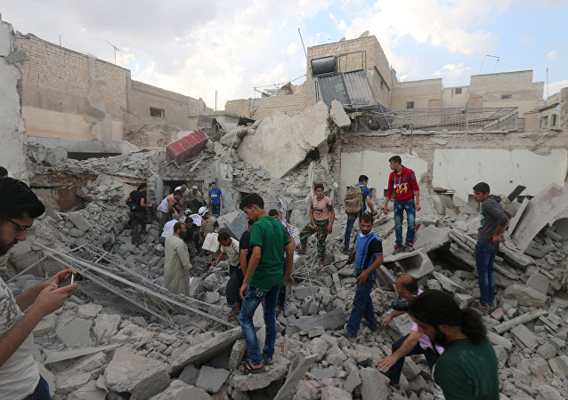 Men look for survivors under the rubble of a damaged building after an airstrike on Aleppo's rebel held Kadi Askar area, Syria July 8, 2016.
