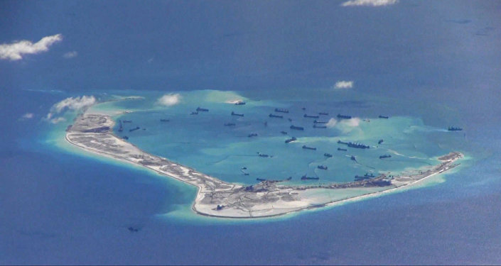 Chinese dredging vessels in the waters around Mischief Reef in the disputed Spratly Islands in the South China Sea, photographed by a USN surveillance aircraft in 2015