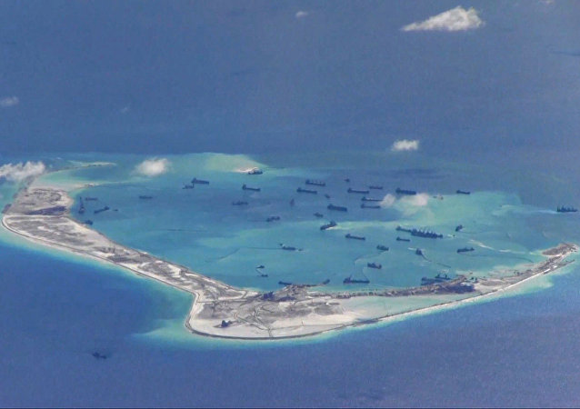 Chinese dredging vessels in the waters around Mischief Reef in the disputed Spratly Islands in the South China Sea, photographed by a USN surveillance aircraft in 2015.