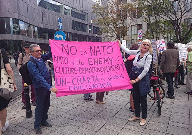 Peace Activists Rally In Warsaw Against Alliance's Expansion