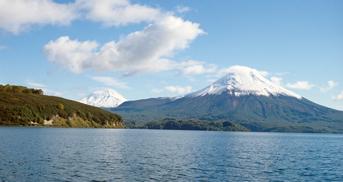 View of Ilyinsky volcano on the shore of Kurile Lake.