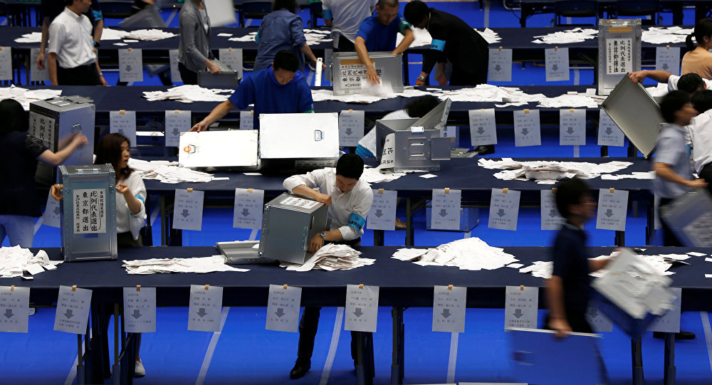 Election officers count votes at a ballot counting centre for Japan's upper house election in Tokyo, Japan July 10, 2016.