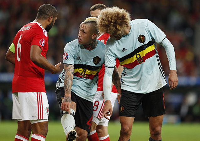 Football Soccer - Wales v Belgium - EURO 2016 - Quarter Final - Stade Pierre-Mauroy, Lille, France - 1/7/16 Belgium's Marouane Fellaini and Radja Nainggolan speak to Wales' Ashley Williams