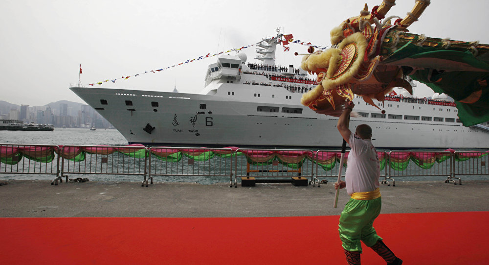 A man performs dragon dance as China's Yuanwang-6 space tracking ship is docked in Hong Kong's Victoria Harbor (File)