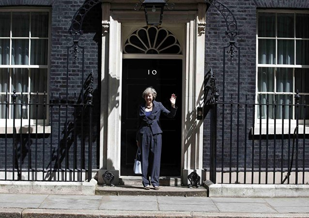 Britain's Home Secretary Theresa May, who is due to take over as prime minister on Wednesday, waves as she leaves after a cabinet meeting at number 10 Downing Street, in central London, Britain July 12, 2016