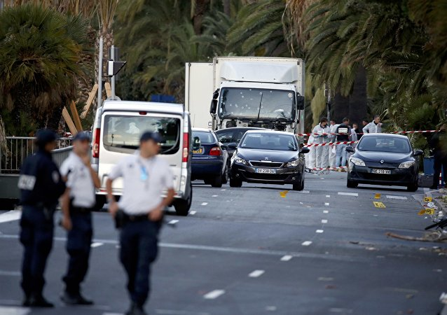French police continue their investigation as they work near the heavy truck that ran into a crowd at high speed celebrating the Bastille Day July 14 national holiday on the Promenade des Anglais killing 80 people in Nice, France, July 15, 2016.