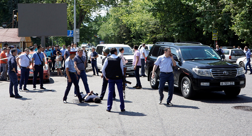 Police officers detain a man after an attack in the centre of Almaty, Kazakhstan, July 18, 2016